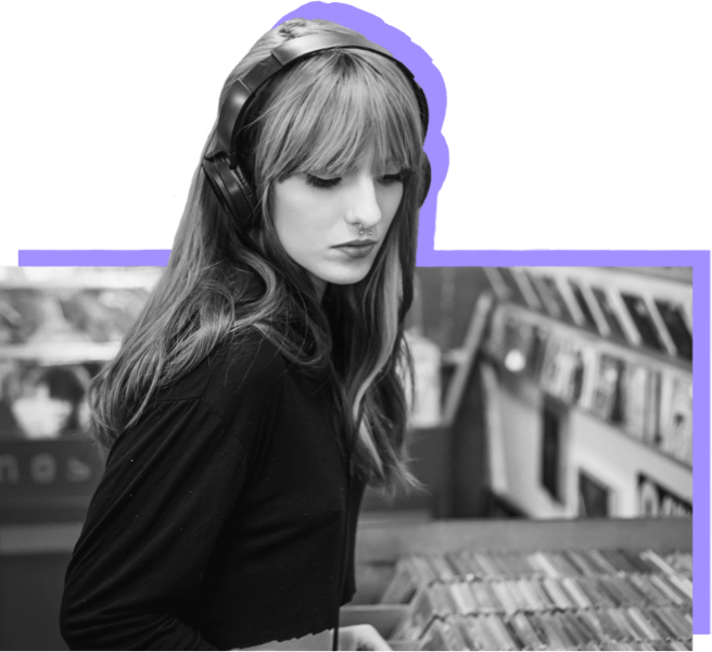 Young woman with headphones looking through CDs
